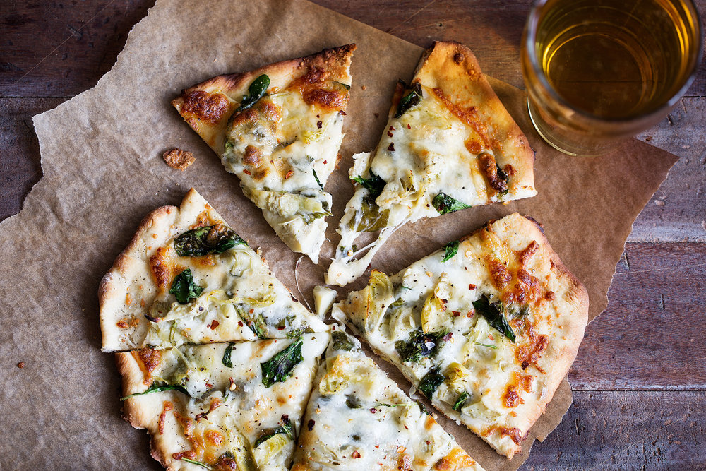 homemade spinach artichoke pizza slices