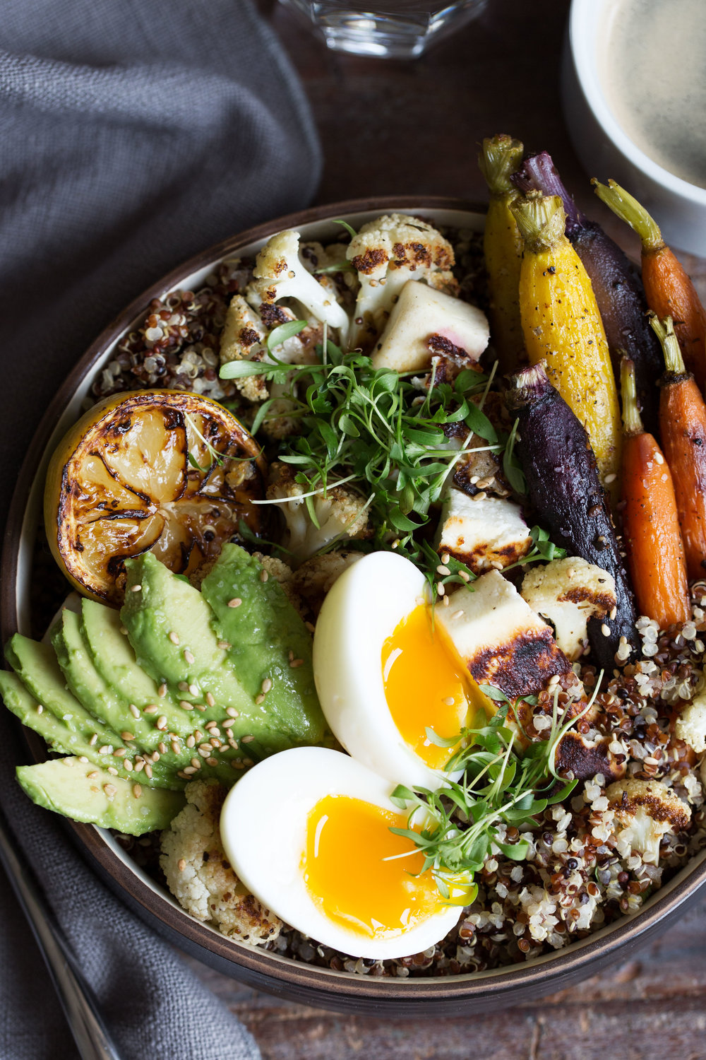 grain bowl with quinoa, soft-boiled egg, roasted carrots and cauliflower