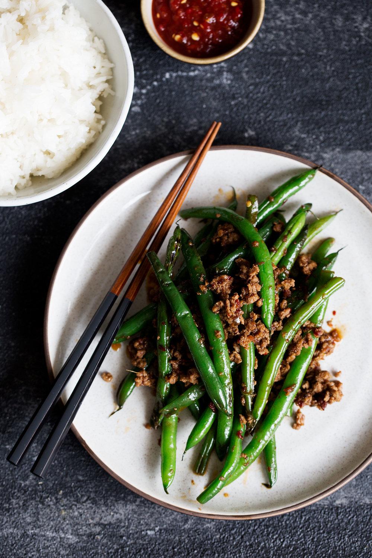 sichuan pan-fried green beans with ground pork closeup