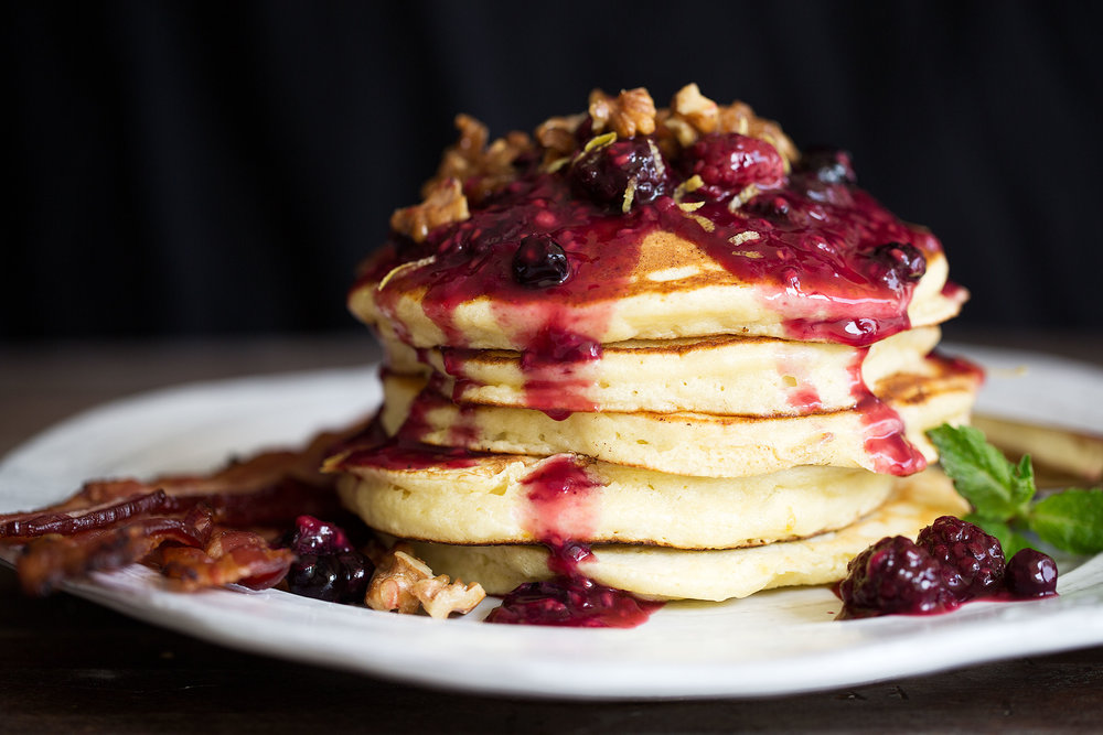 lemon ricotta pancakes with mixed berry compote and candied walnuts