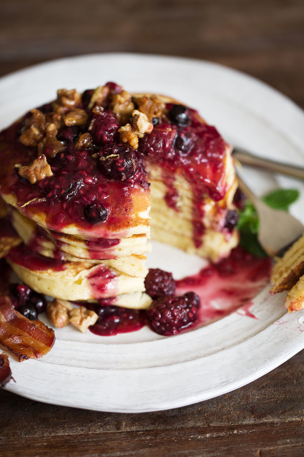lemon ricotta pancakes with mixed berry compote and candied walnuts cut