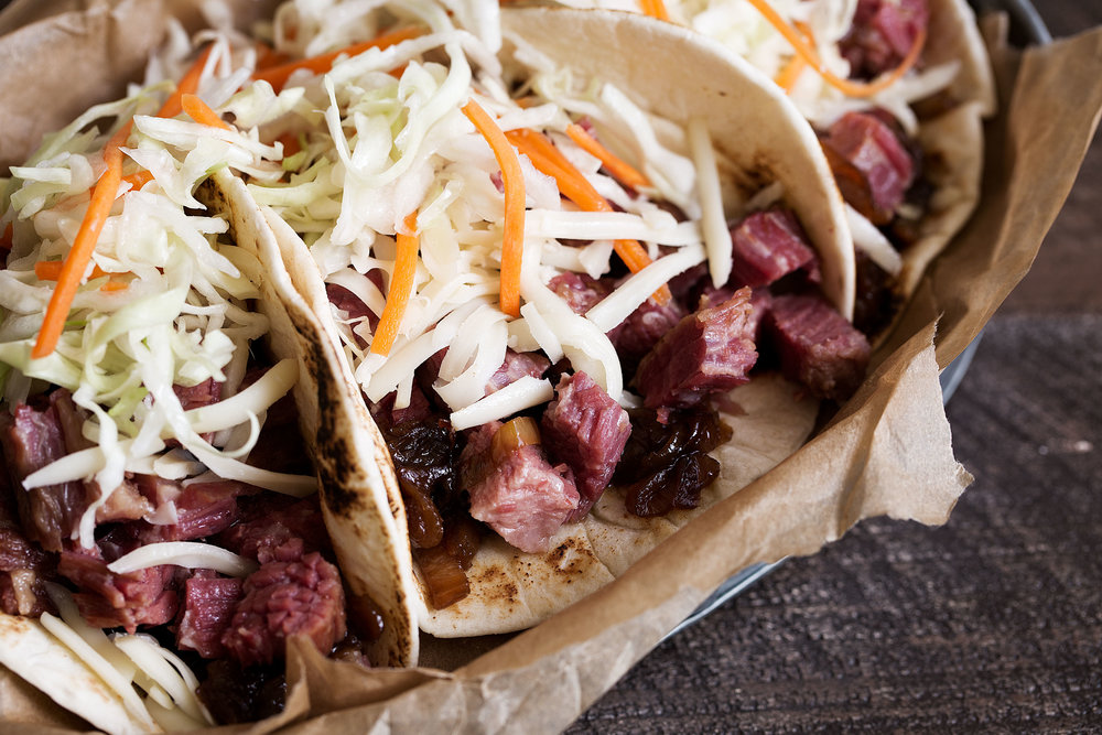irish tacos with corned beef and guinness caramelized onions closeup