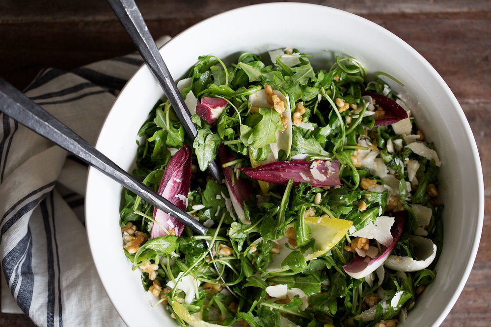 arugula and endive salad with candied pine nuts