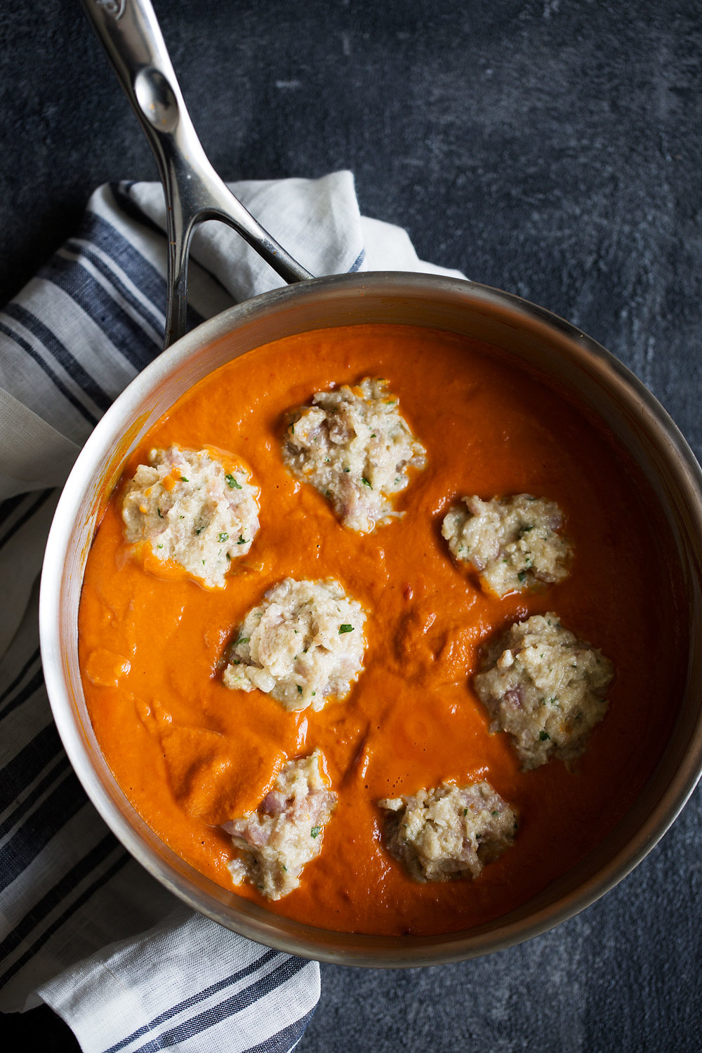 meatballs dropped into coconut curry sauce