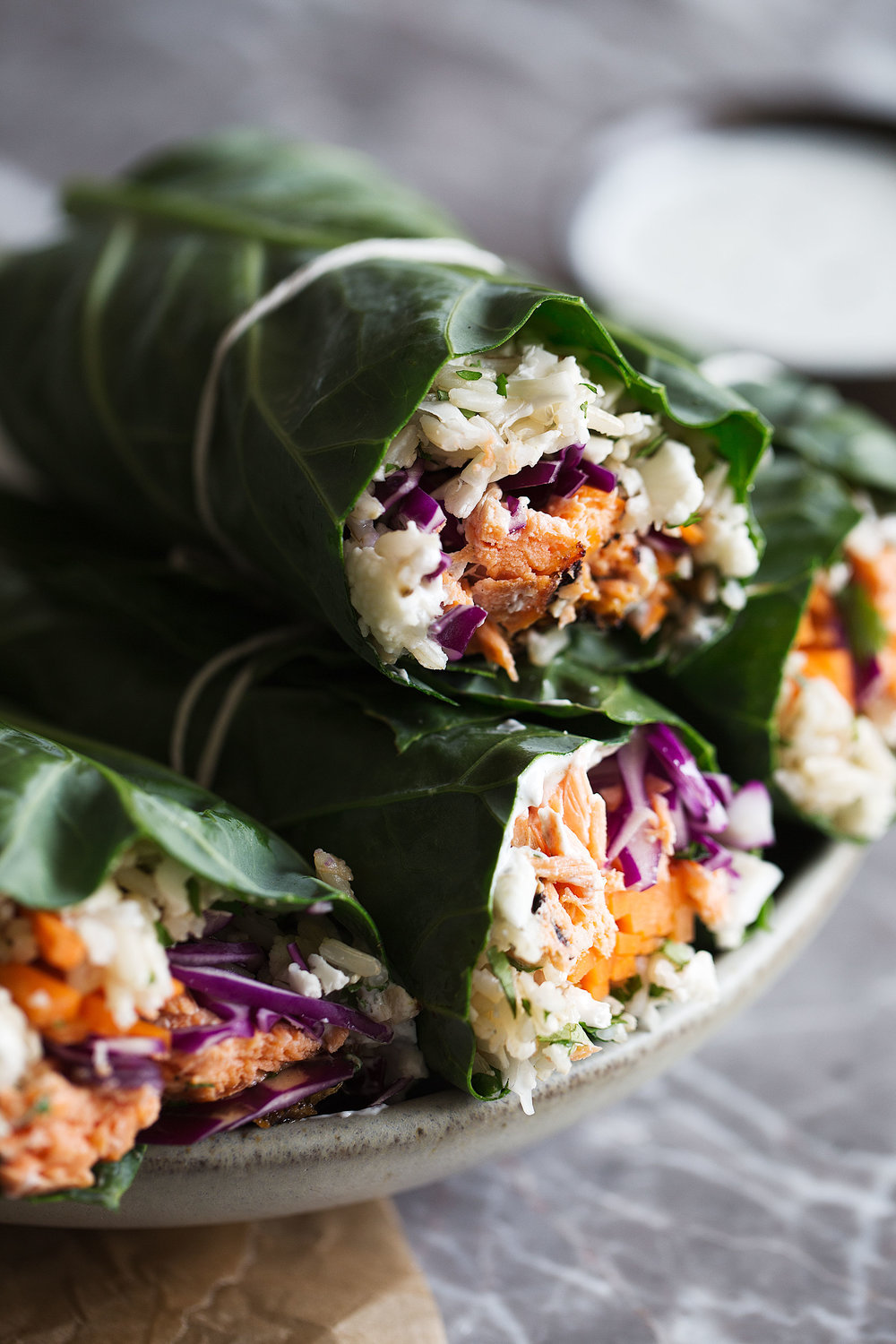 closeup Grilled BBQ Salmon and Veggie Collard Green Wraps with Ranch Yogurt Sauce