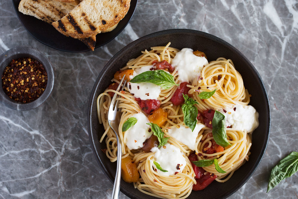 homemade spaghetti with confit cherry tomatoes, burrata and basil