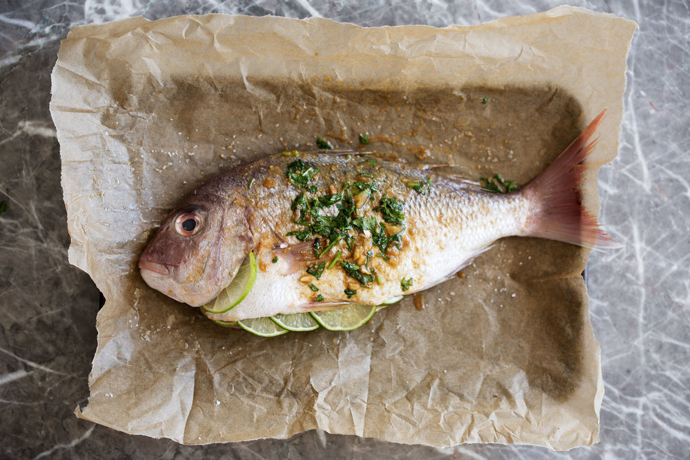 red snapper with asian spices ready for roasting in oven