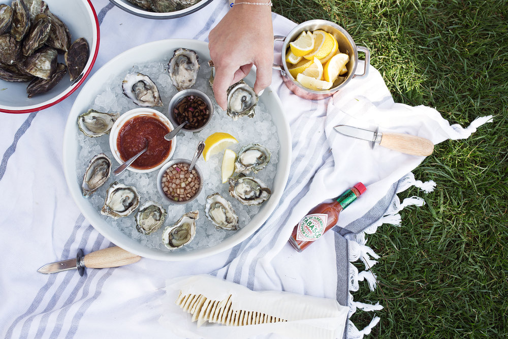 shucking oysters in the park