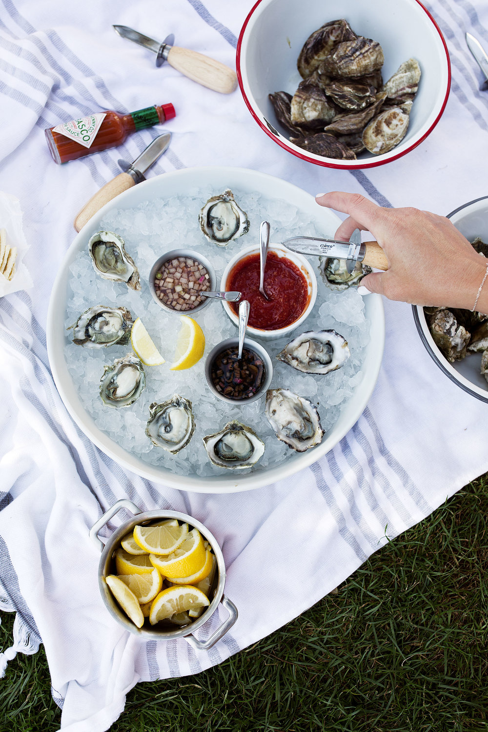adding oysters to plate - freshly shucked
