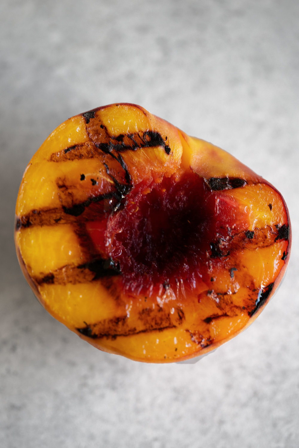 grilled peach closeup cooking with cocktail rings