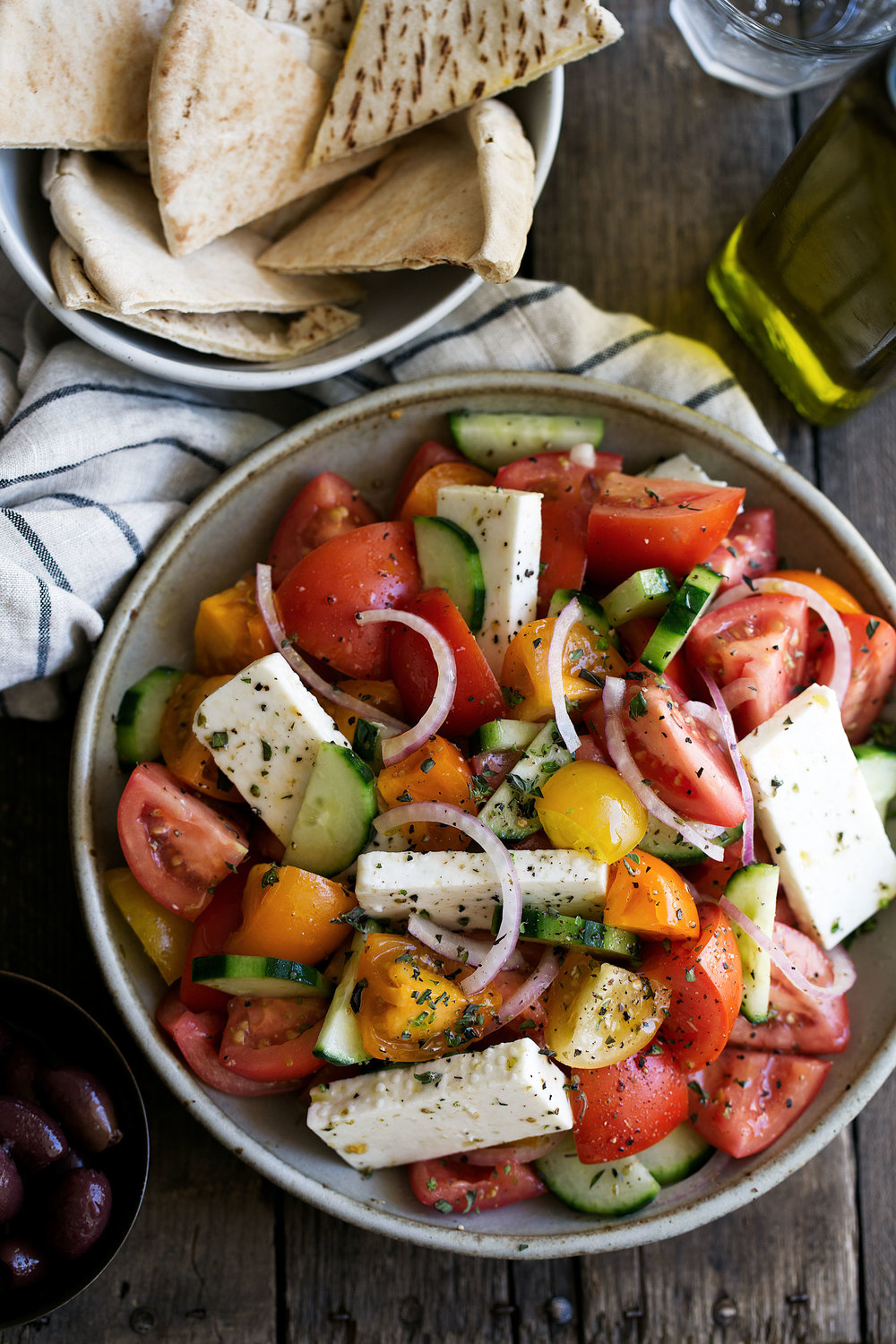 greek salad with tomato, cucumber, feta and red onion cooking with cocktail rings