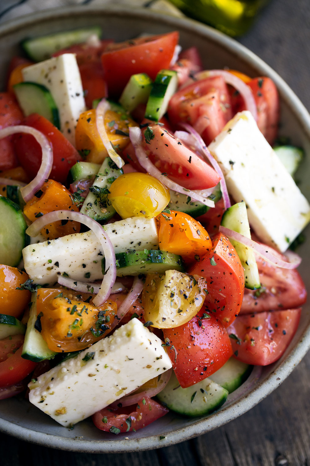 closeup shot greek salad cooking with cocktail rings