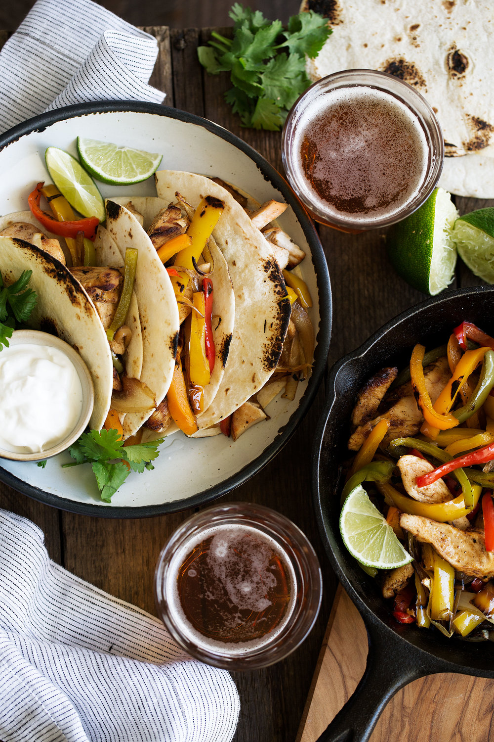Tequila lime chicken fajitas cooking with cocktail rings overhead