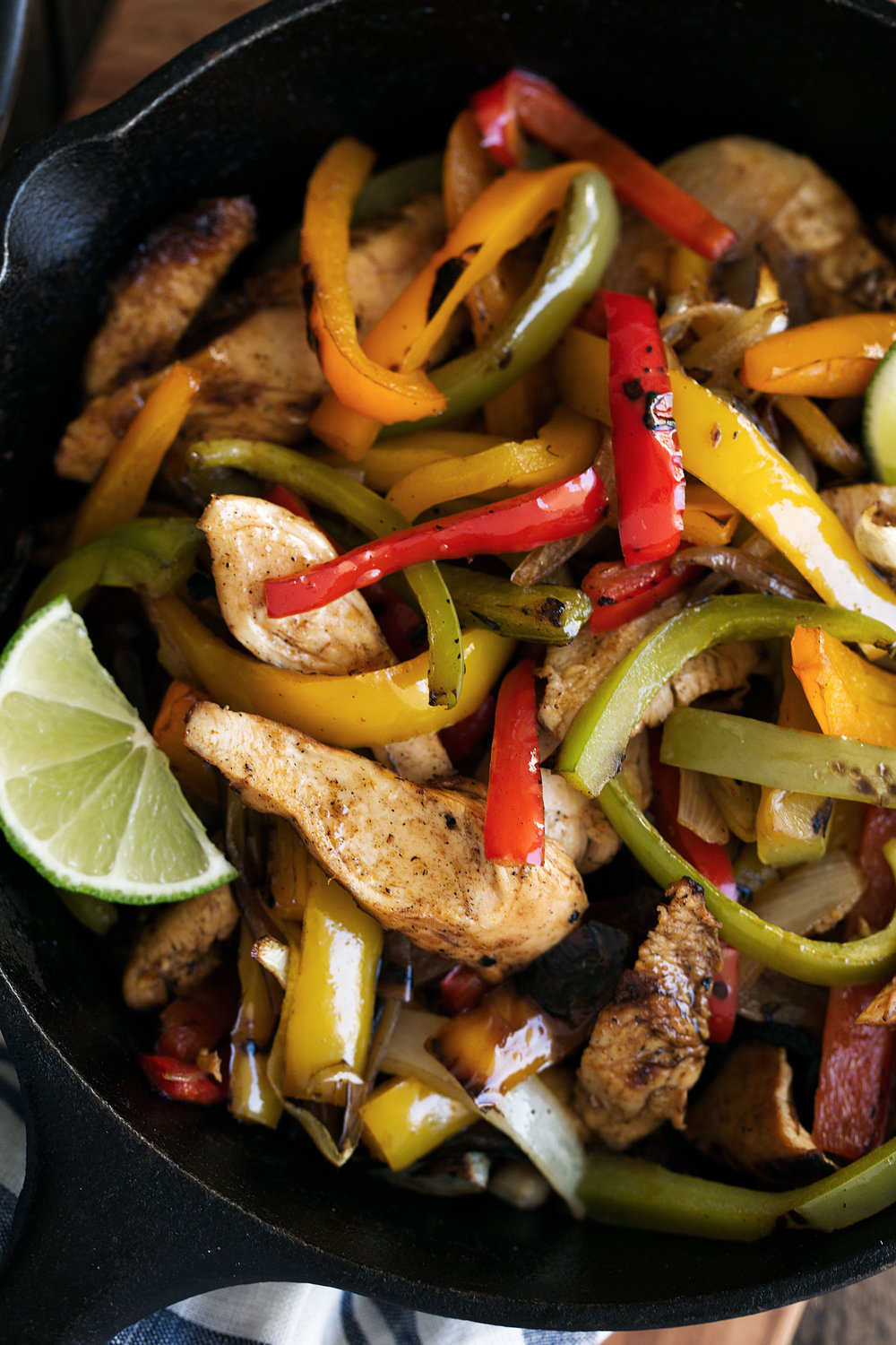 Tequila lime chicken fajitas cooking with cocktail rings