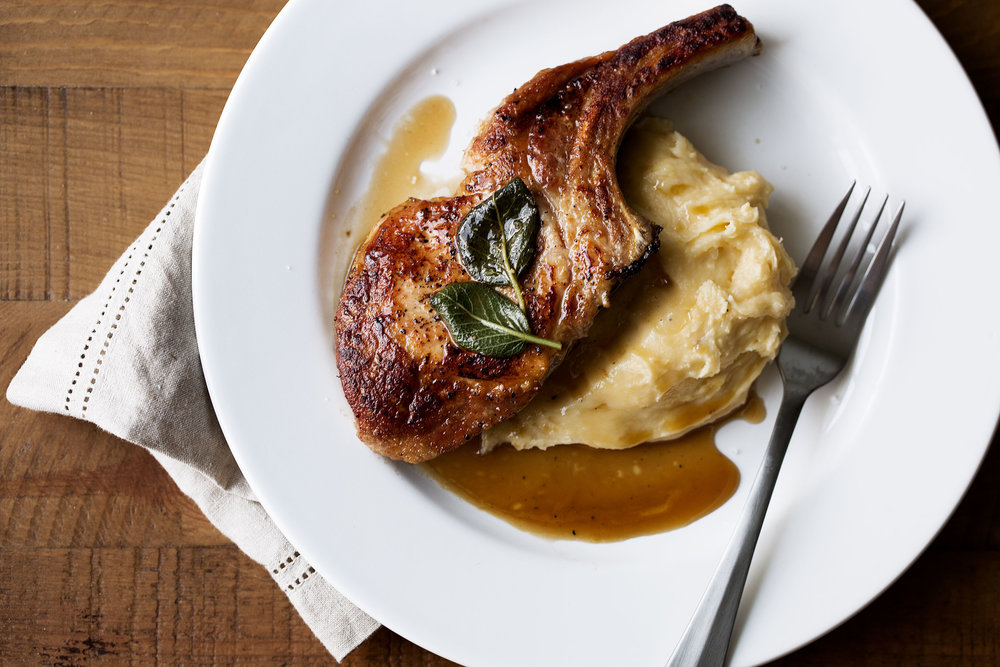 apple cider and sage glazed bone-in pork chops with cheddar potatoes