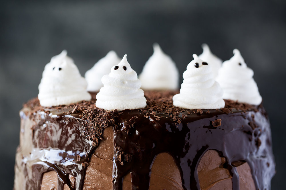 Dark Chocolate Cake with Raspberry Filling, Chocolate Ganache and Meringue Ghosts recipe from Cooking with Cocktail Rings closeup