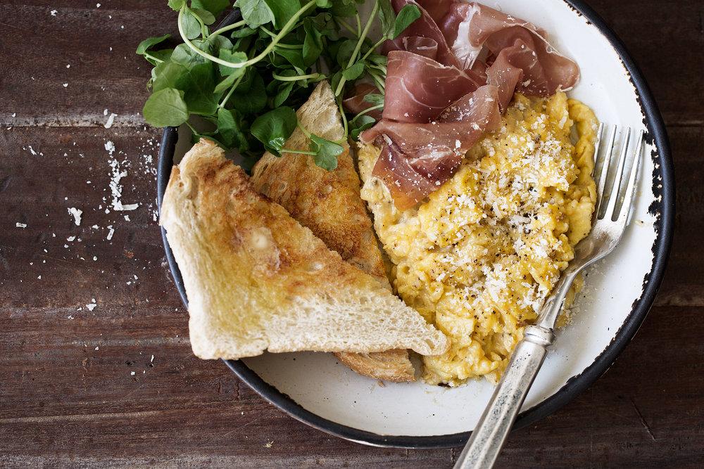 cacio e pepe slow scrambled eggs with prosciutto