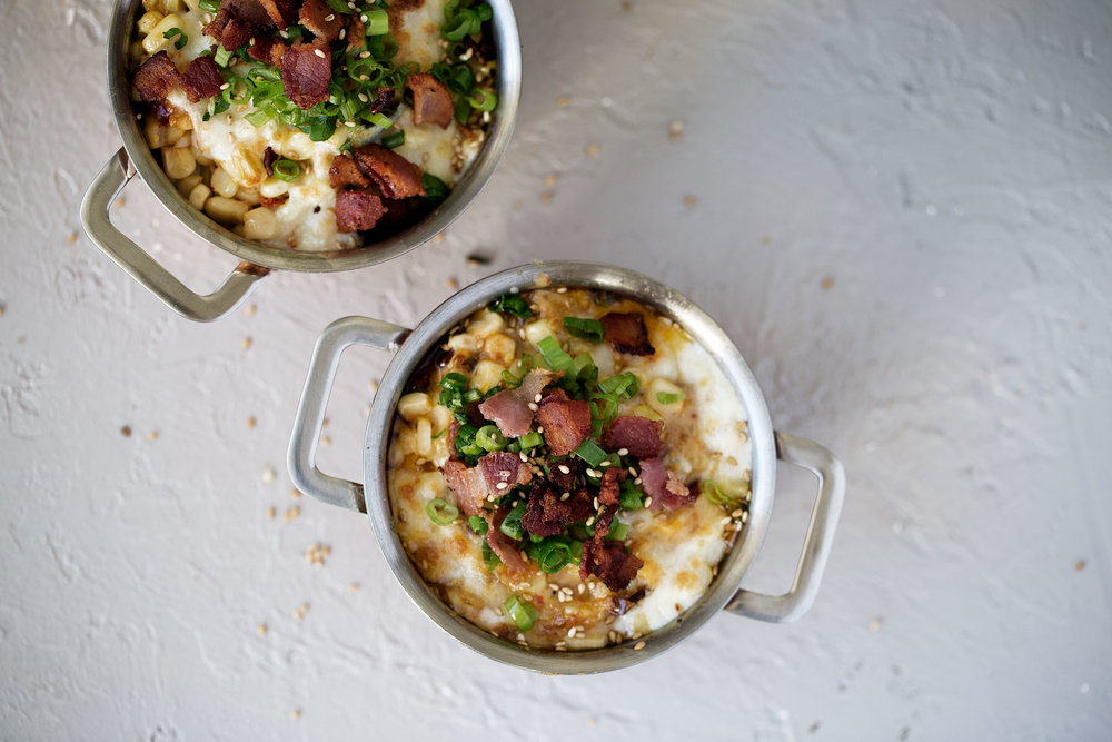 spicy cheesy corn with bacon cooking with cocktail rings