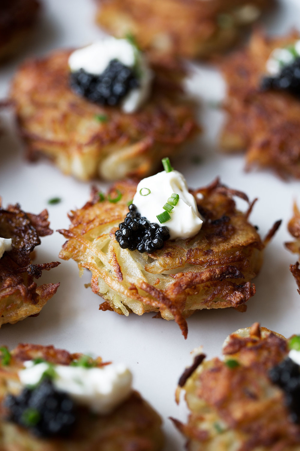 mini bougie latkes topped with caviar from cooking with cocktail rings