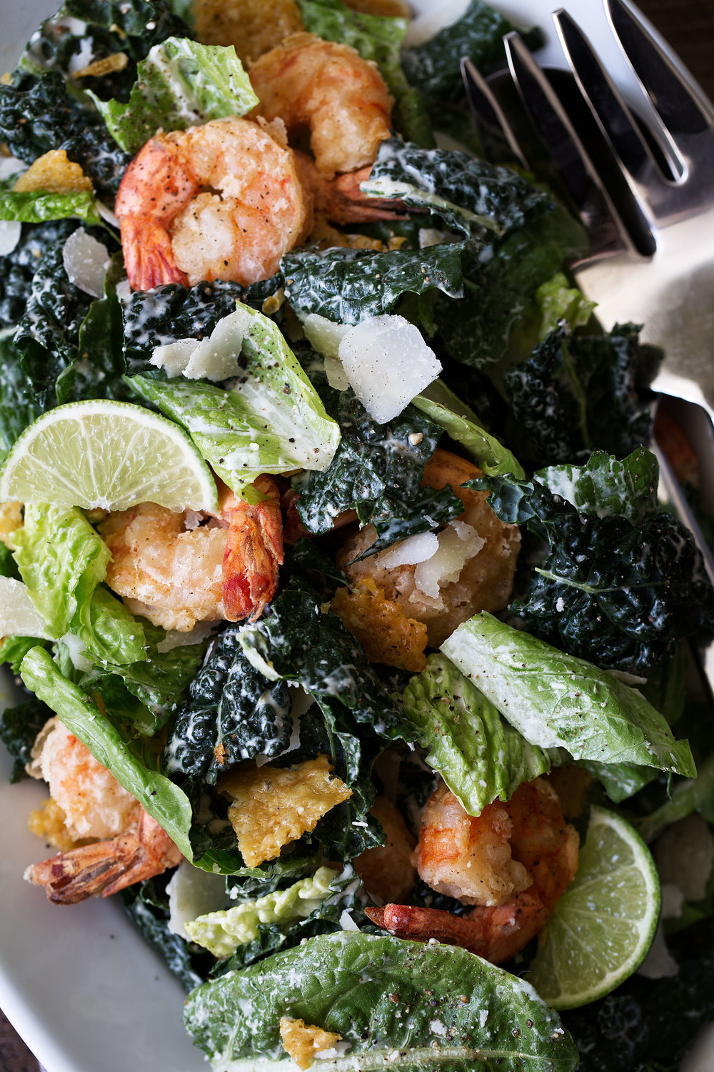 Kale Caesar Salad with Lime and Crispy Shrimp recipe from cooking with cocktail rings closeup
