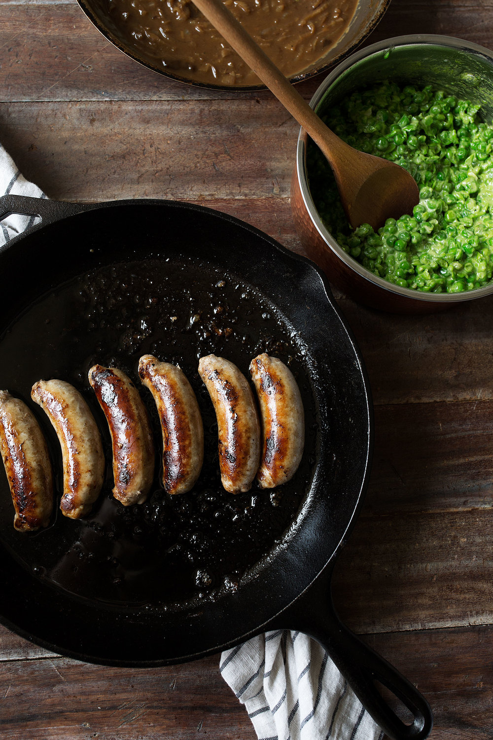 bangers and cauliflower mash with guinness onion gravy and mushy peas ingredients st. patrick's day