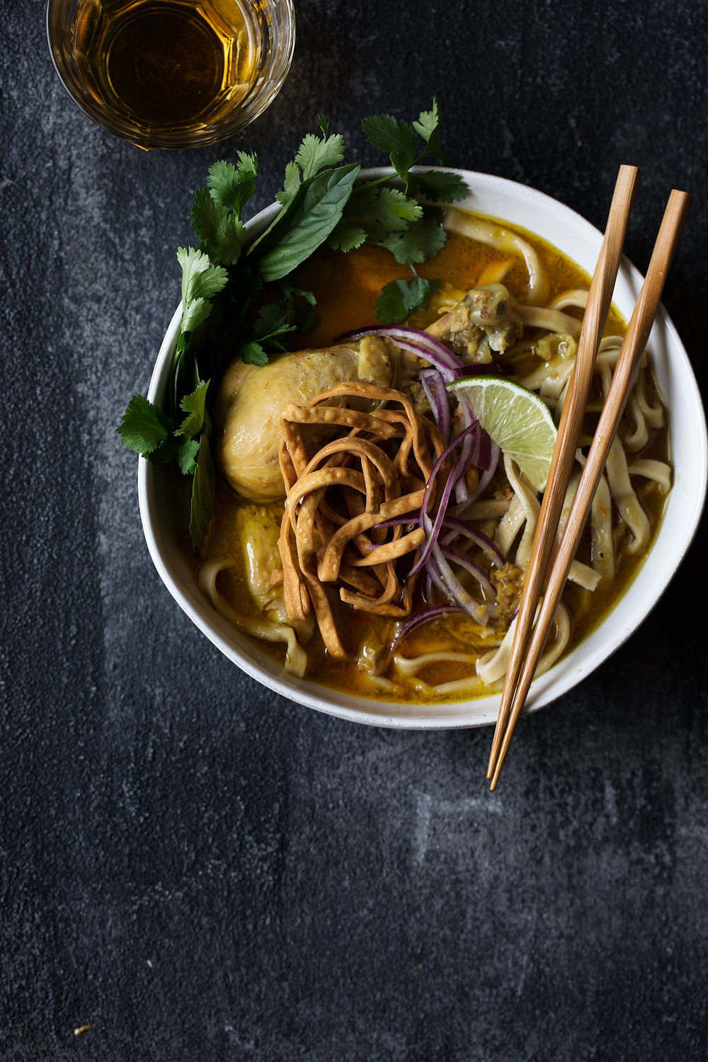 chicken khao soi cooking with cocktail rings