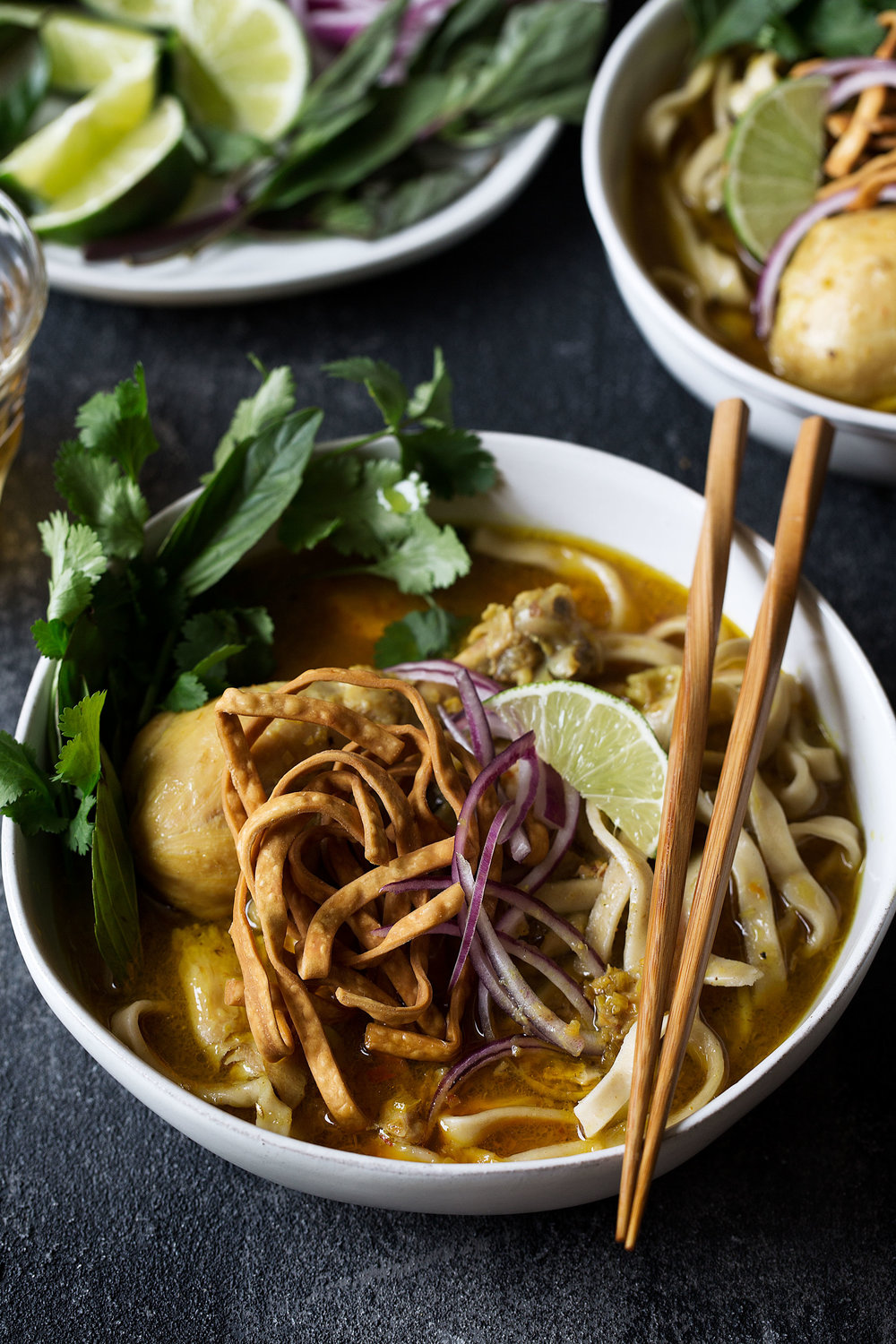closeup bowl chicken khao soi recipe from cooking with cocktail rings