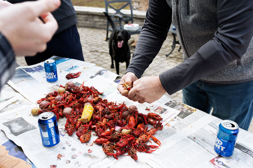 traditional southern crawfish boil recipe from cooking with cocktail rings peeling crawfish