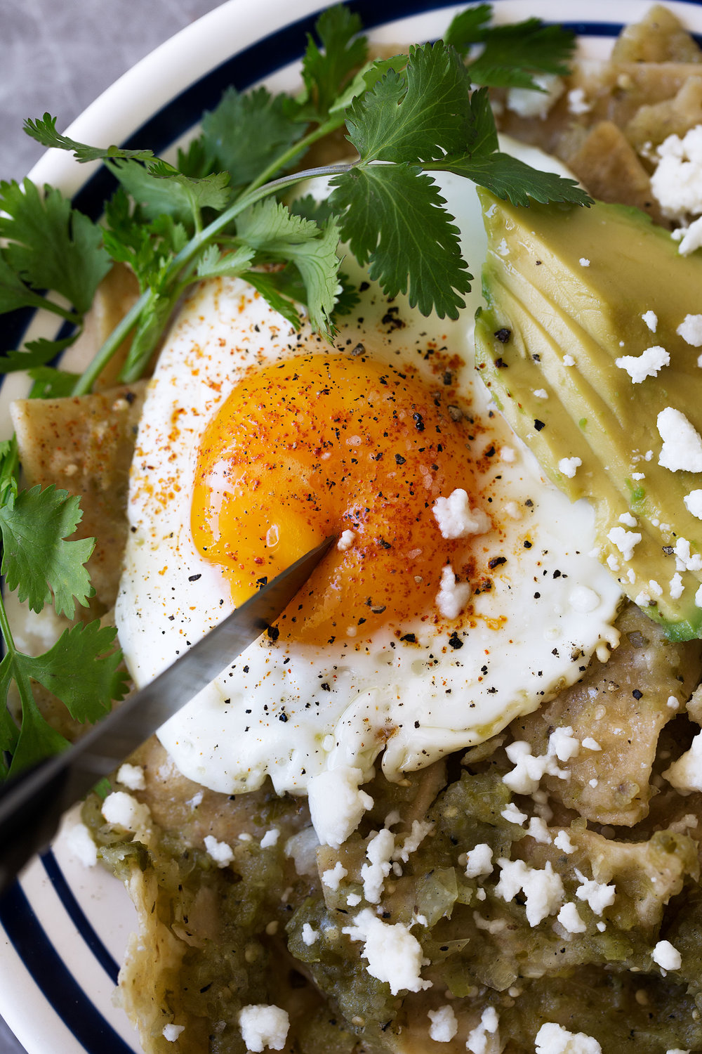 chilaquiles verdes with a fried egg recipe from cooking with cocktail rings yolk pop