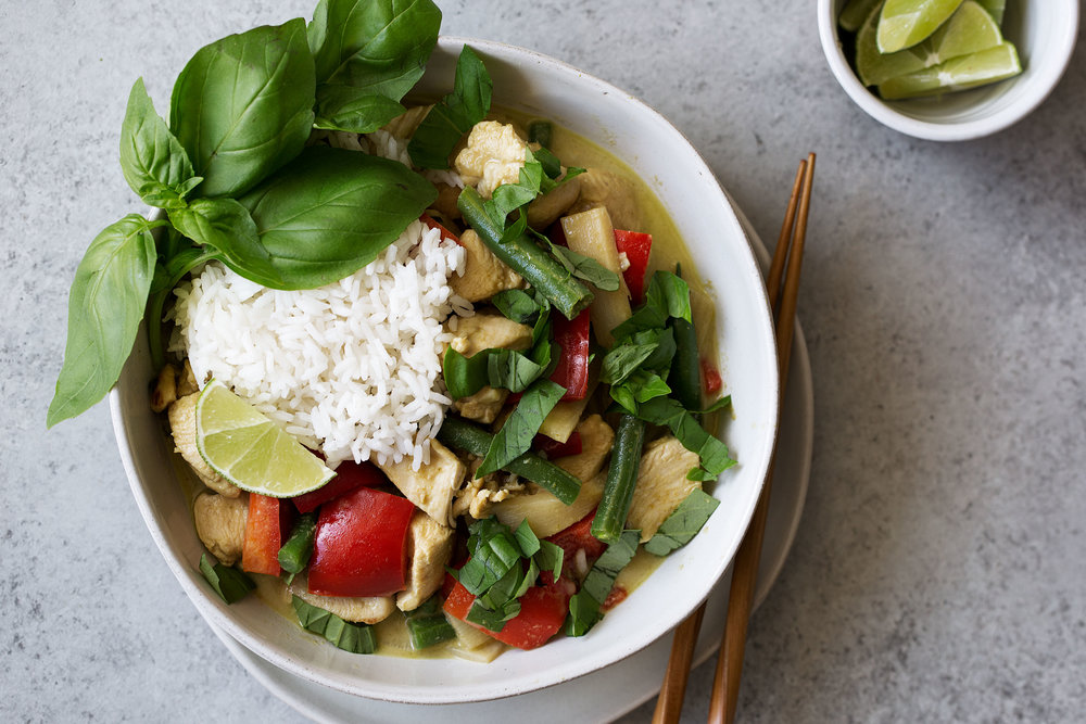 thai green curry chicken cooking with cocktail rings