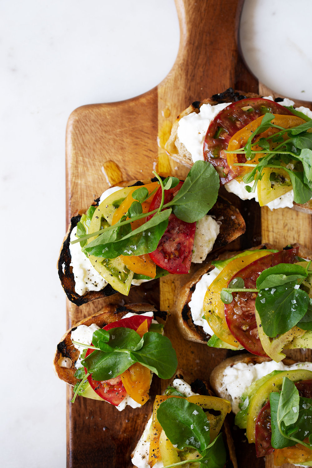 Heirloom Tomato, Avocado & Burrata Tartines recipe from cooking with cocktail rings