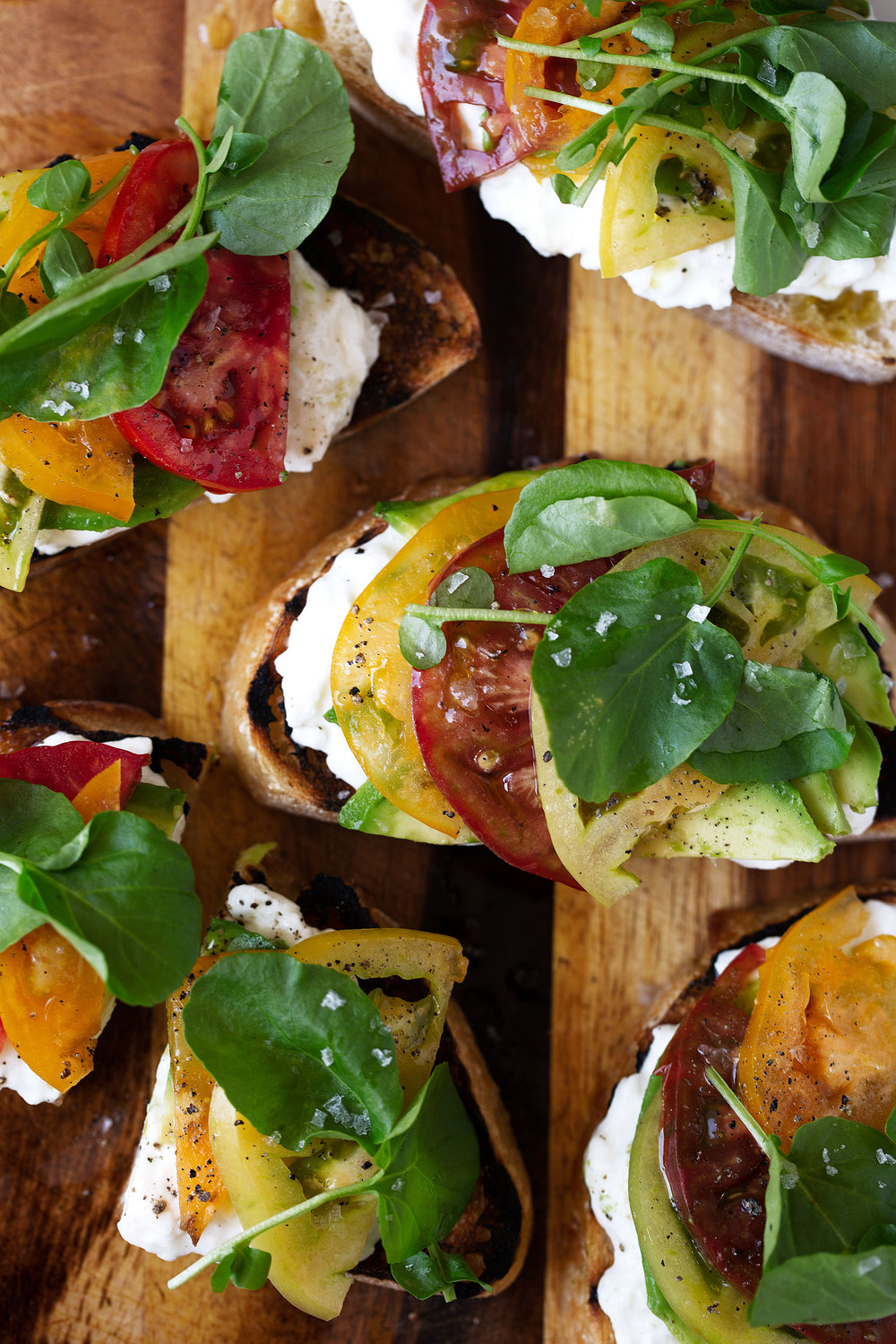 Heirloom Tomato, Avocado & Burrata Tartines recipe from cooking with cocktail rings overhead