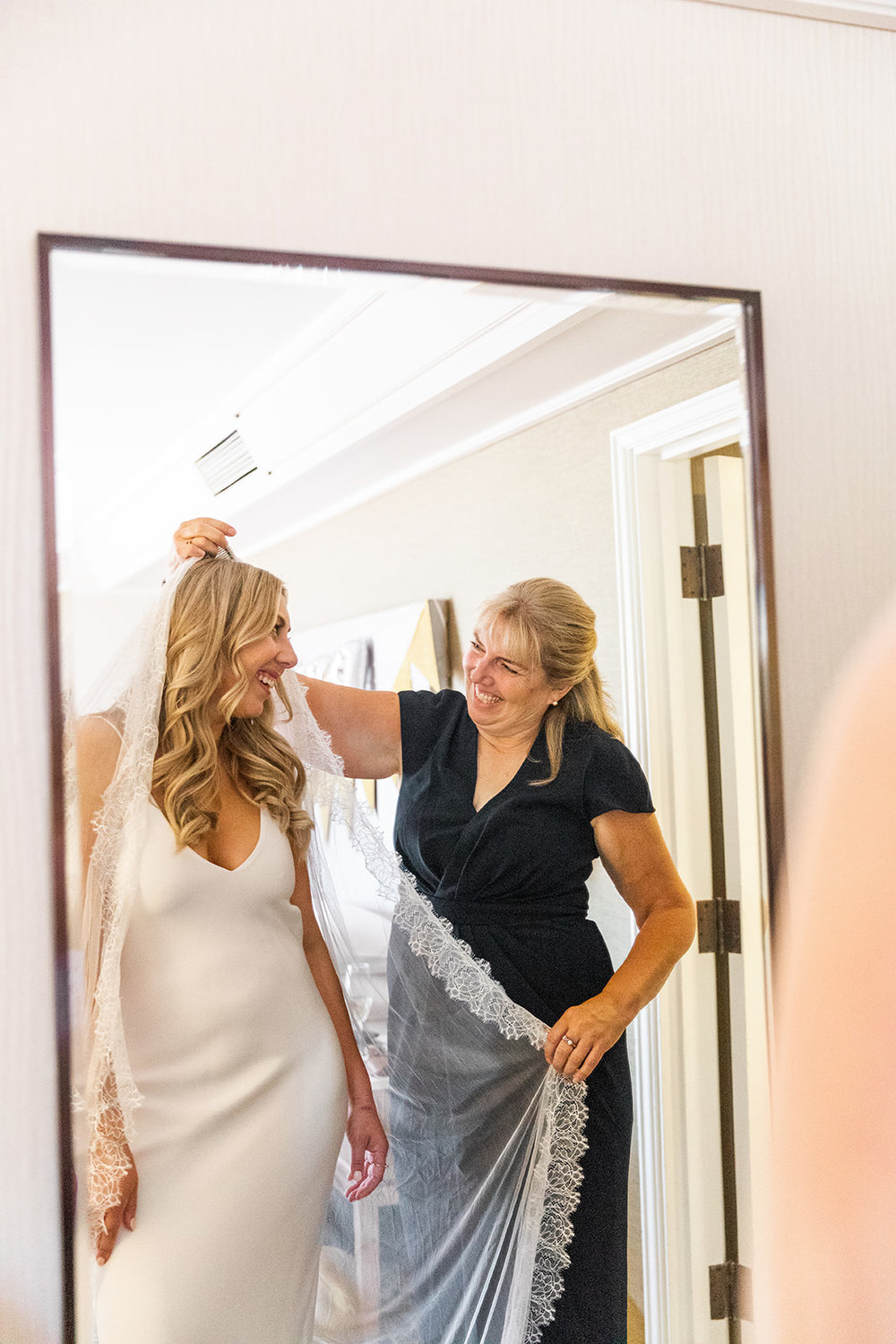 getting ready with mom wedding bridal suite