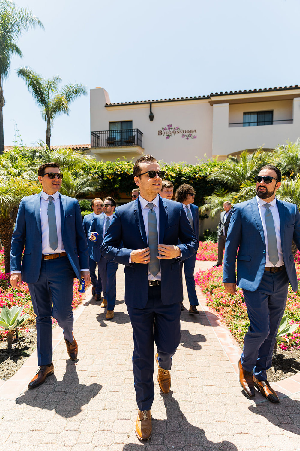 groomsmen walking out of hotel santa barbara wedding
