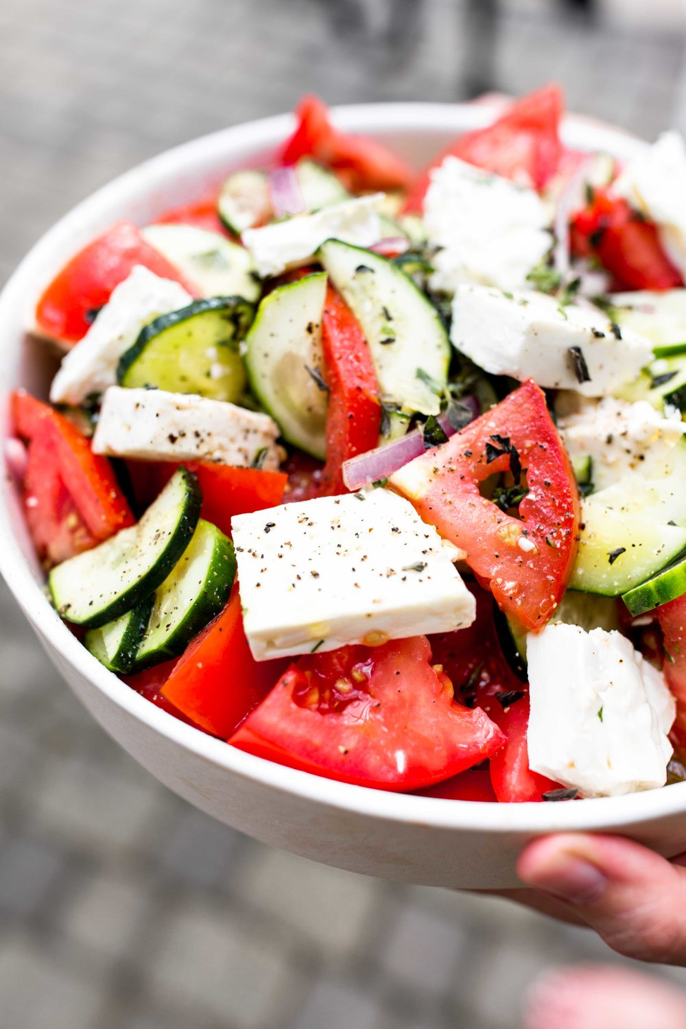 closeup greek salad cooking with cocktail rings