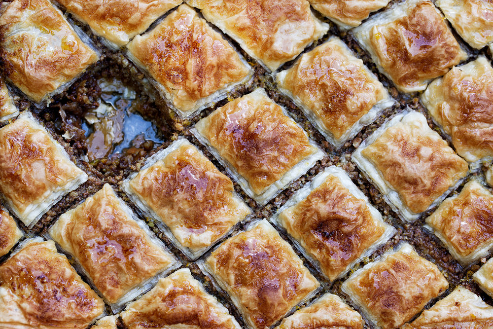 closeup baklava cooking with cocktail rings