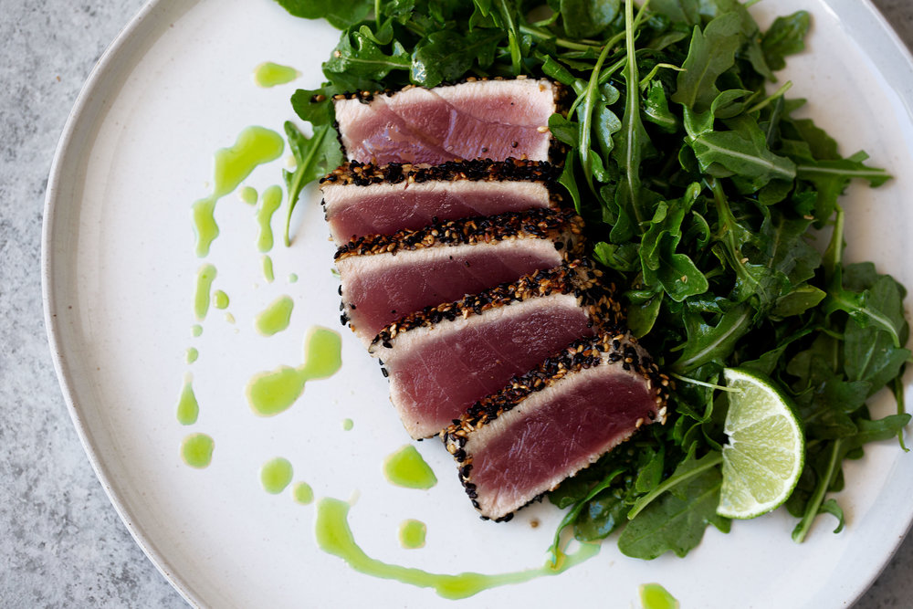 sesame crusted seared ahi tuna cooking with cocktail rings