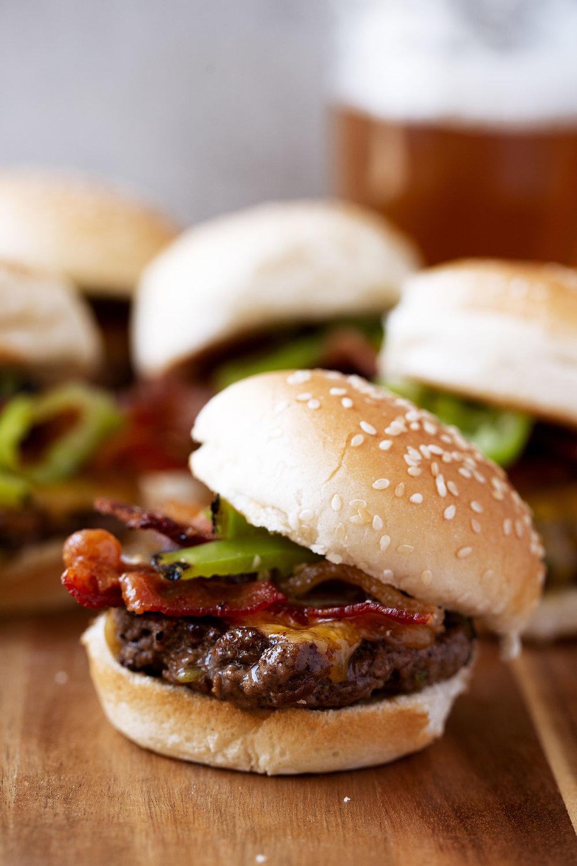 Hatch Chili & Cheddar Bacon Smash Burger Sliders closeup