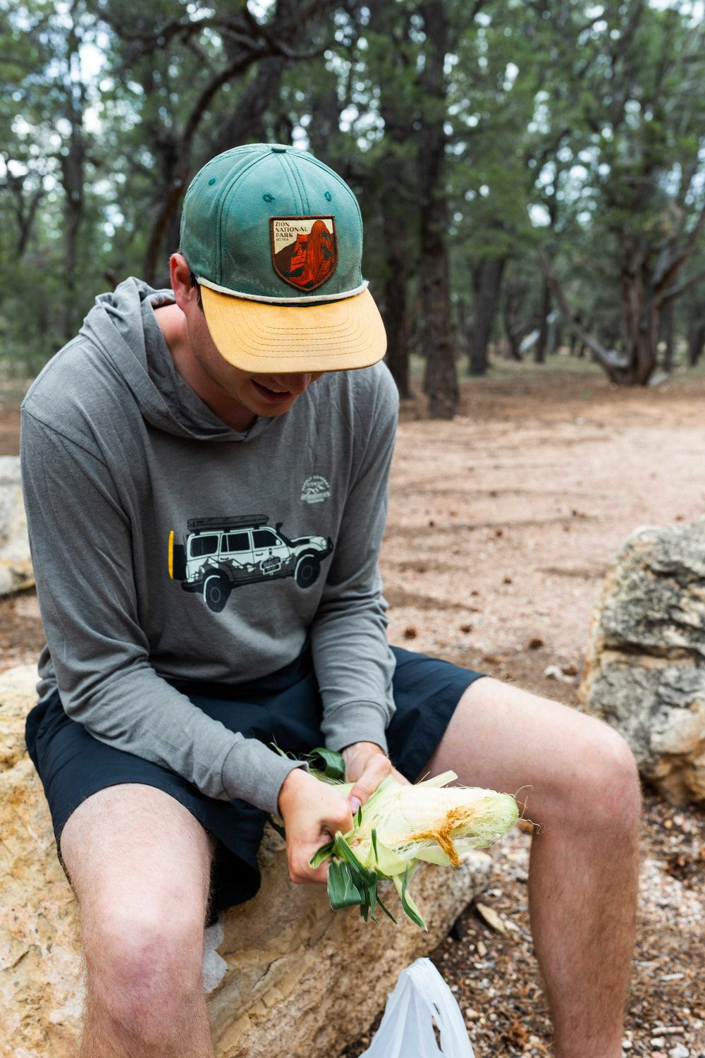 arizona road trip cooking with cocktail rings dinner camping grand canyon josh shucking corn