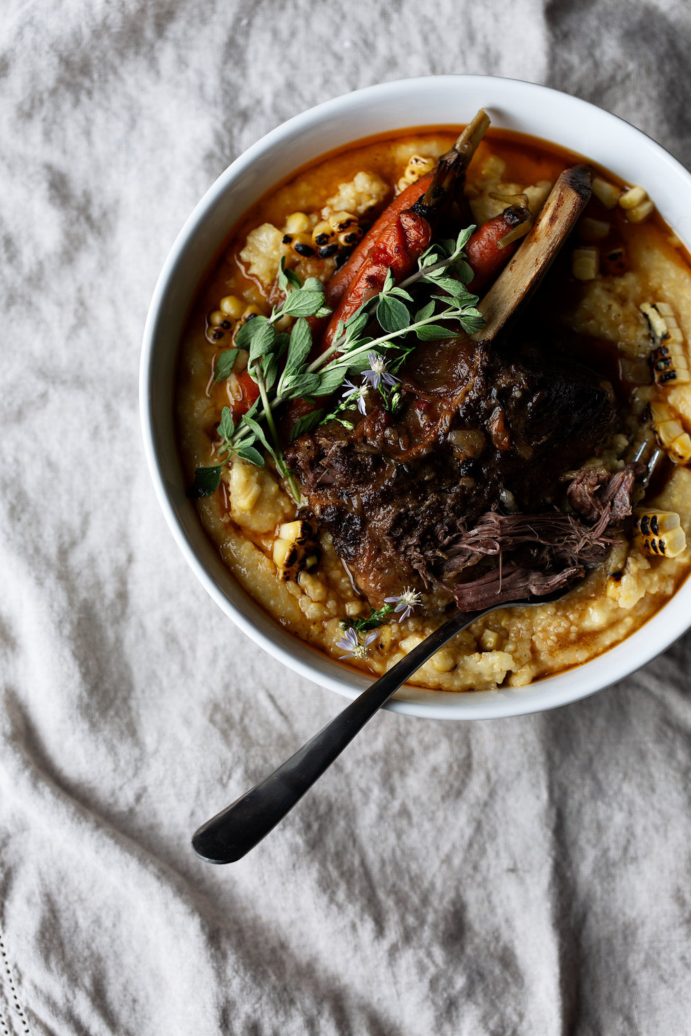 Chili Braised Short Ribs with Carrots and Charred Corn Polenta recipe from cooking with cocktail rings