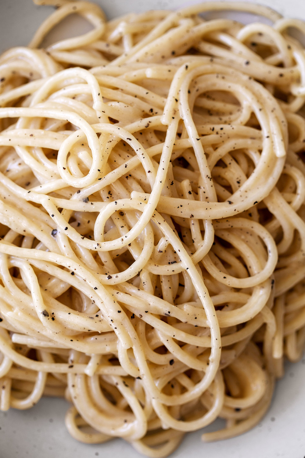 cheesy pasta cacio e pepe recipe from cooking with cocktail rings