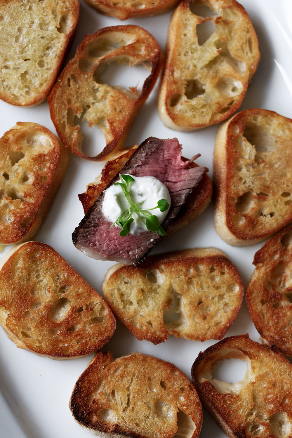 steak and boursin cheese crostini cooking with cocktail rings