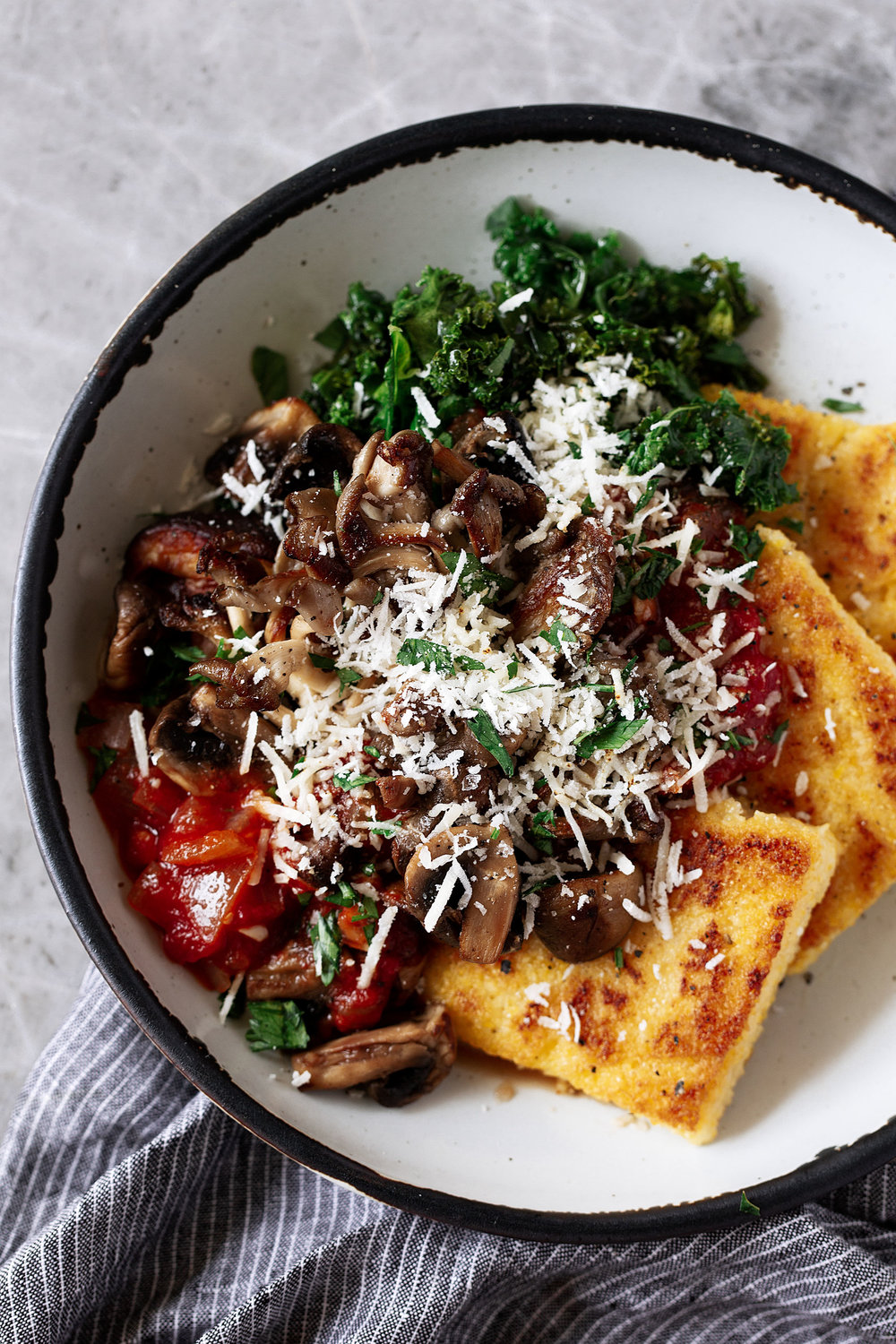 Crispy Polenta with Spicy Tomato Sauce, Sautéed Kale & Mushroomscloseup cooking with cocktail rings