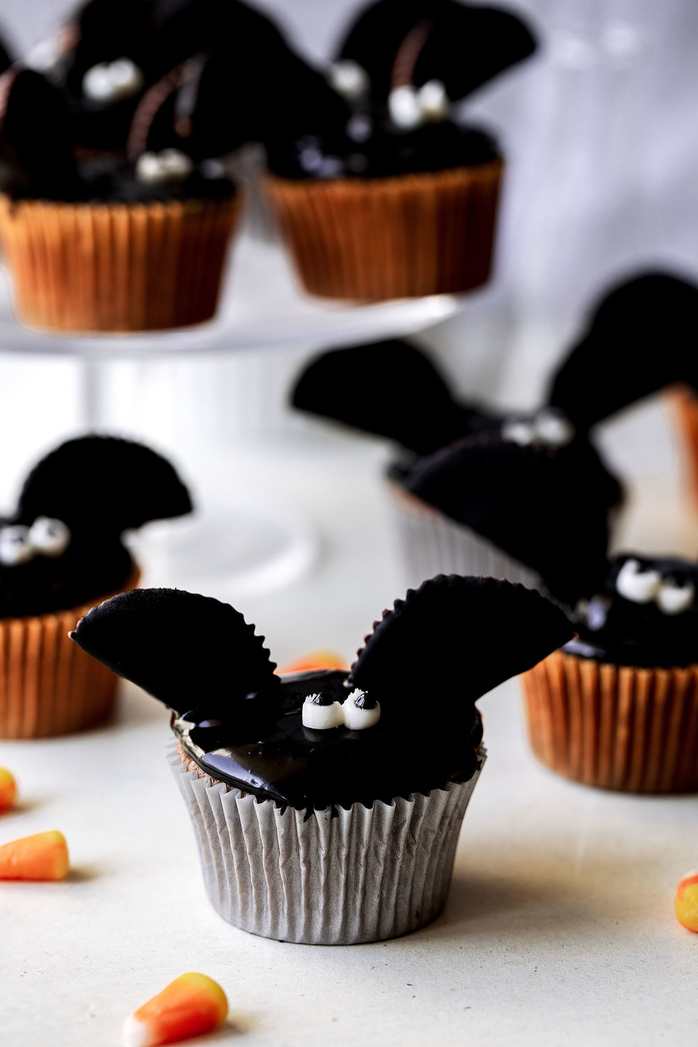 Chocolate Peanut Butter Bat Cupcakes halloween holiday recipe from cooking with cocktail rings closeup