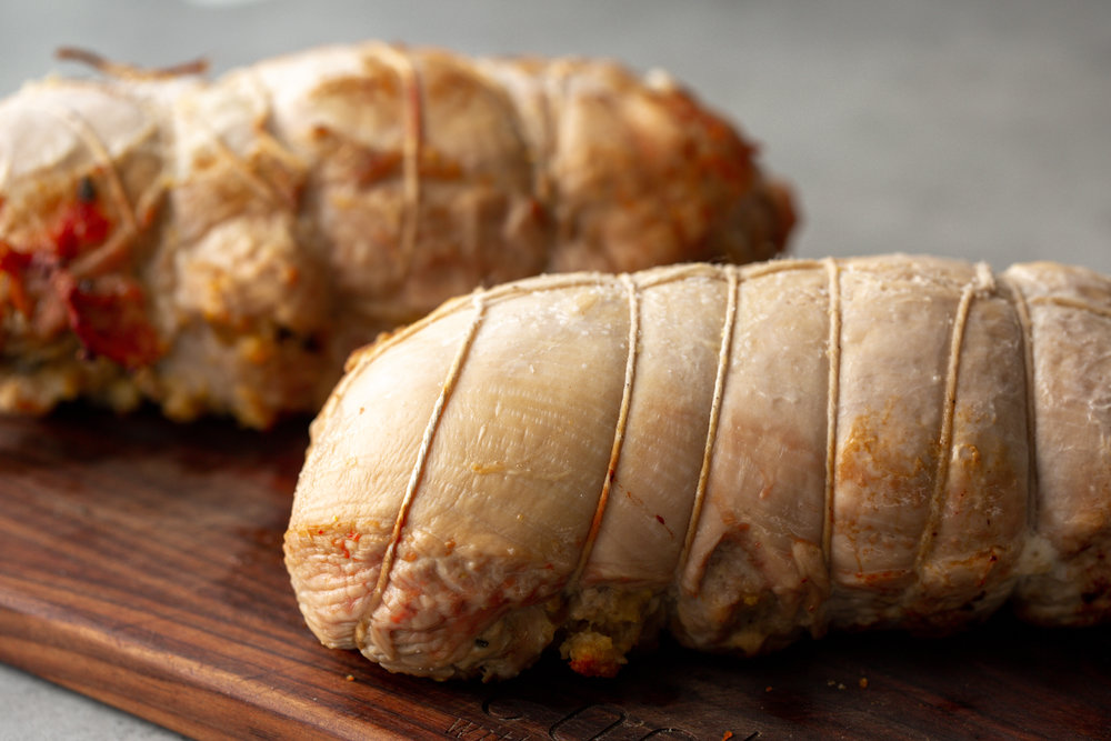 Turkey Roulades with stuffing tied up cooking with cocktail rings