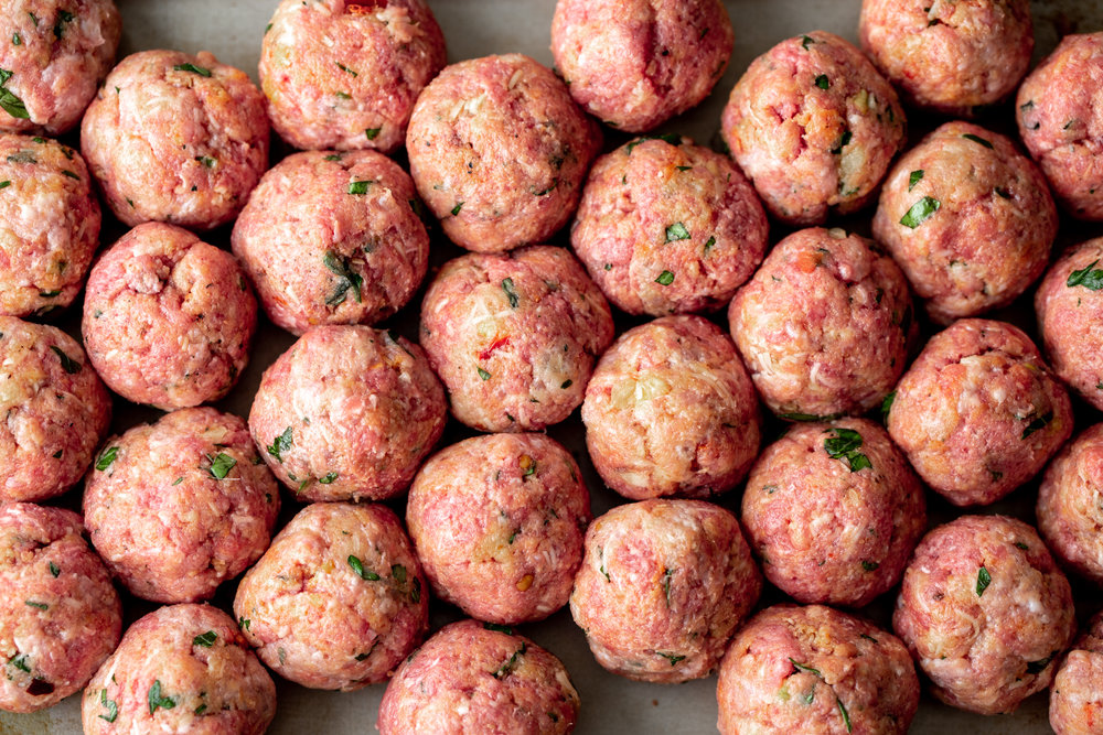 spicy beef and pork meatballs ready for oven