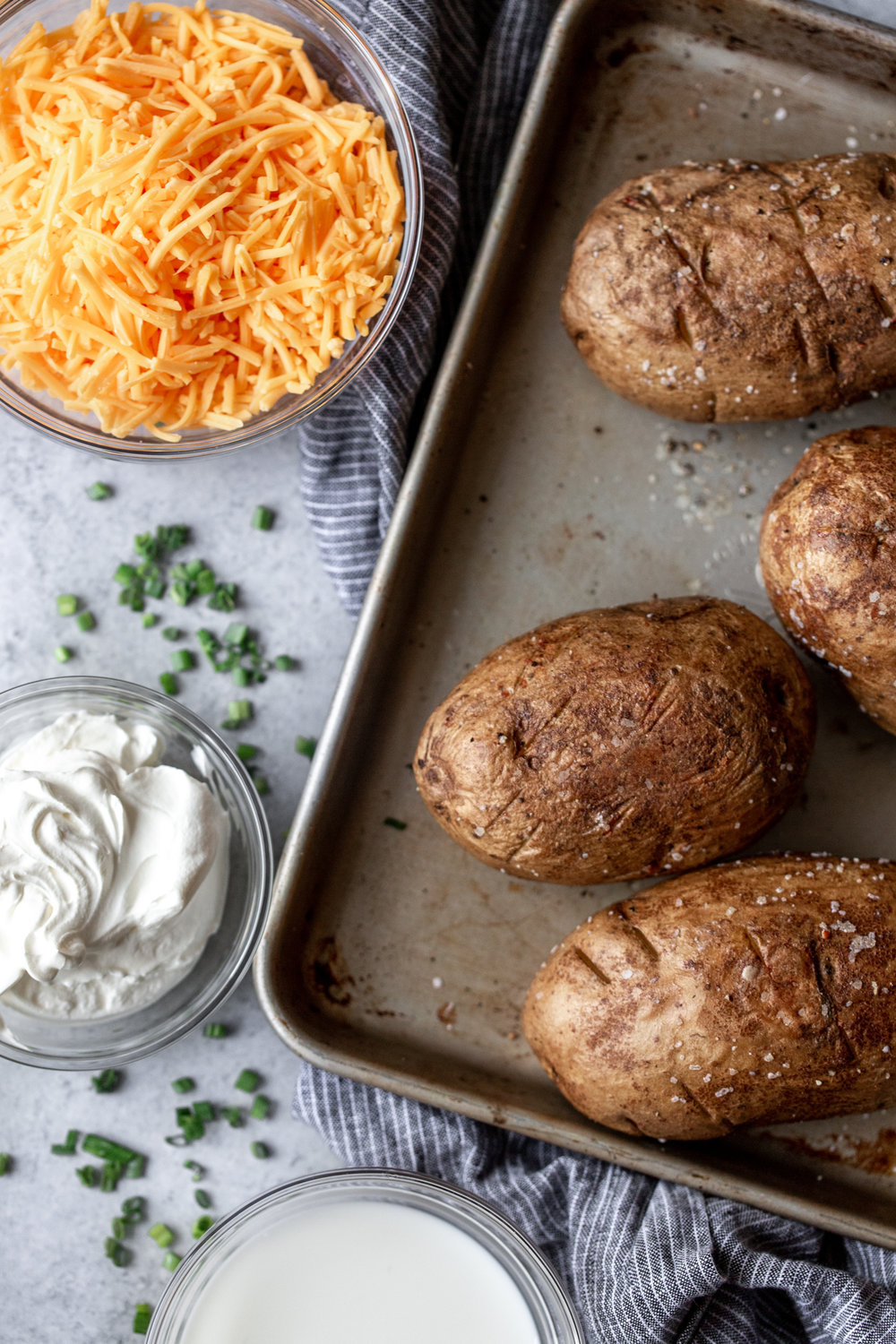 Cheesy Cheddar Twice Baked Potatoes recipe from cooking with cocktail rings ingredient shot