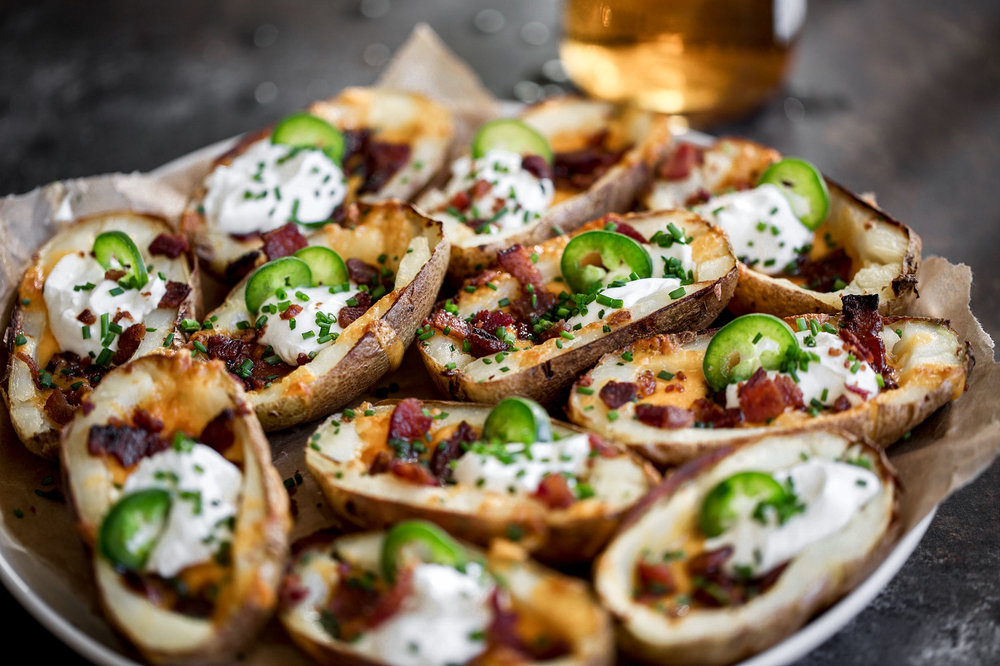 closeup game day potato skins and beer