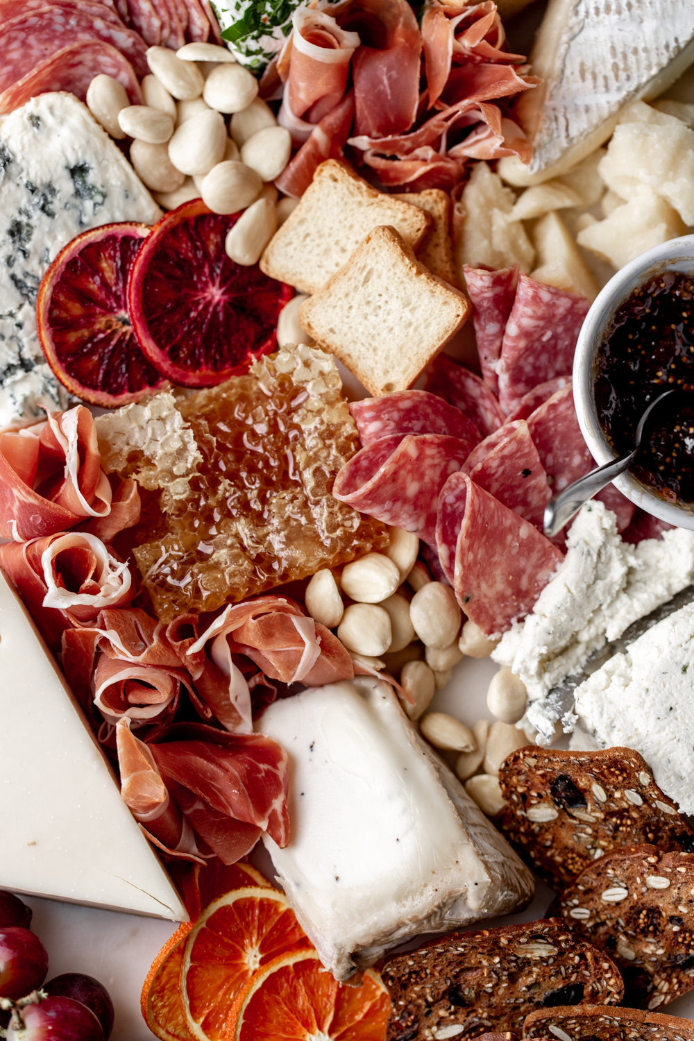 How to put together a cheese and charcuterie board closeup