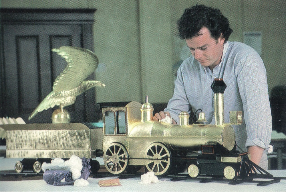 1987 - Franz L. Steiner Jr. Gold leafing a custom weather vane for a customers home.